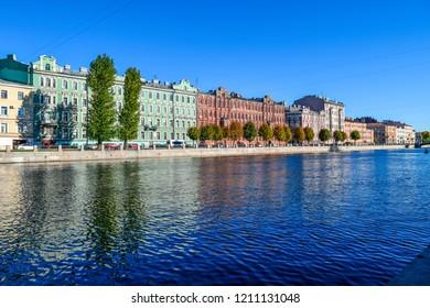 City river houses panorama in Saint Petersburg, Russia. Autumn Fontanka river in Saint Petersburg, Russia. Autumn city river embankment panorama