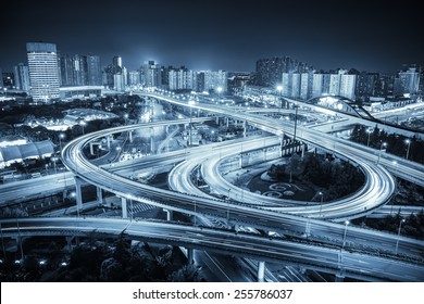 city road junction at night ,interchange highway with blue tone