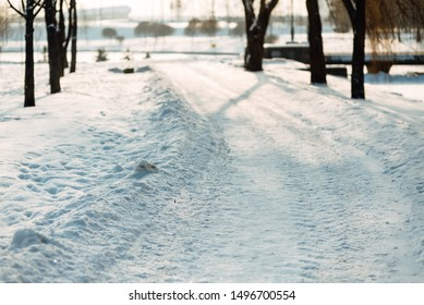 city road in winter after snowfall