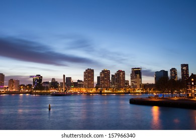 City of Rotterdam river view at twilight in Netherlands, South Holland province.