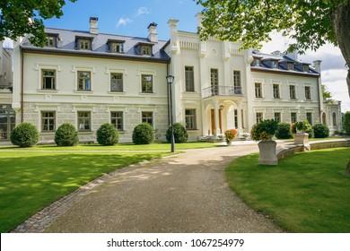 City Rumene, Latvia. Manor, old building and grass, trees. Travel photo. 2017