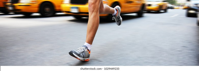 City run runner man running in street panoramic crop for copy space. Urban lifestyle active people training cardio workout jogging on road.
