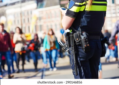 city safety and security. policeman watching order in the urban street
