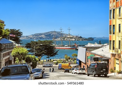 City of San Francisco California United States of America historical skyline panoramic street view Embarcadero downtown fishermans wharf Alcatraz island retro ocean yacht moored to pier