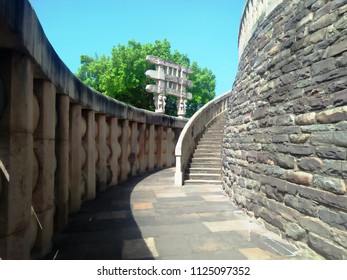 CITY sanchi , STATE madhya pradesh a state of india - july 1, 2018 : Great Sanchi Stupa Gallery Deambulatory pathway Shunga balustrade and staircase.