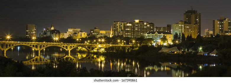The city of Saskatoon at night along the South Saskatchewan River