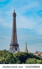 City scape with Eiffel tower and park trees in spring, Paris, France