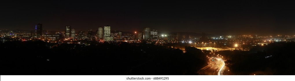 City scape at night with cars and traffic