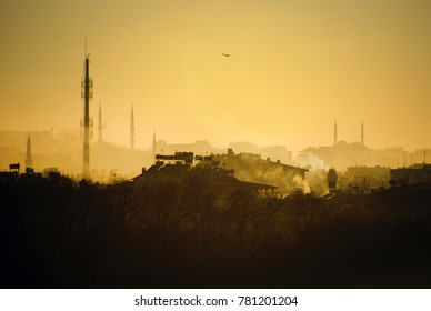 City scape in a smoky day .Building silhouettes and yellow sky.