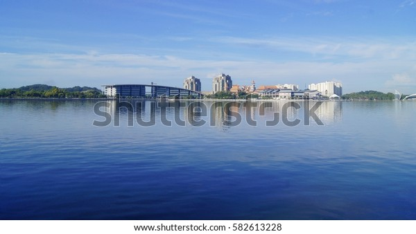 A city scape view by the lake with building reflection in the water under blue sky in Putrajaya, Malaysia