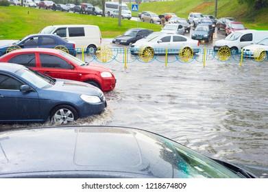 City scene with car traffic on flooded street, Kiev, Ukraine