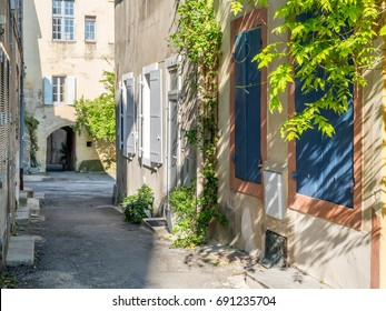 City scene in old classic city, Arles, France, under clear blue sky