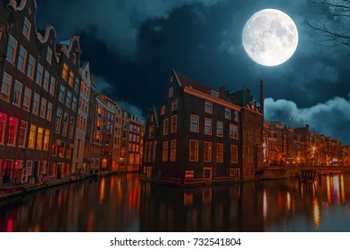 City scenic in Amsterdam the Netherlands at night by full moon