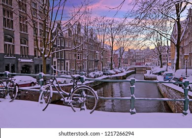 City scenic from Amsterdam in winter in the Netherlands at sunset