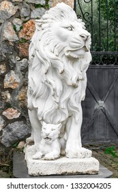 City sculpture of a lion and a lion cub at the entrance. Local landmark. Front view