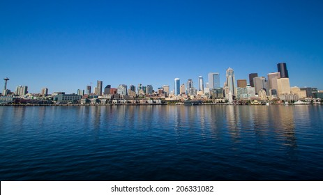 The city of Seattle, reflected in the waters of Elliott Bay