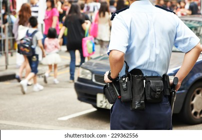 city security. policeman watching order in the urban street