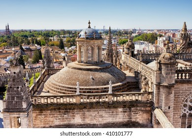 City of Seville in Andalusia, Spain, Gothic architecture of Sevilla Cathedral, rooftop, dome and finials, cityscape