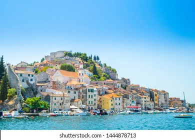 City of Sibenik on the Adriatic coast in Dalmatia, Croatia, fishing and sailing boats in harbor, old town in background