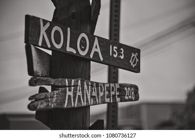 City signs made of wood in Kauai, Hawaii. The photo is in black and white