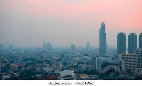 City and sky at twilight in bangkok, Thailand. Building in dark grey color