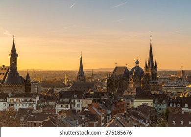 city skyline of aachen with cathedral and town hall at morning sunset