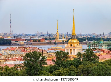 City skyline with the Admiralty spire, Peter and Paul Fortress, river Neva and Hermitage Winter Palace viewed from the roof of Saint Isaac's Russian Orthodox Cathedral in Saint Petersburg, Russia