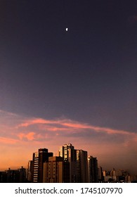 City Skyline in a beautiful gradient sunset and the moon