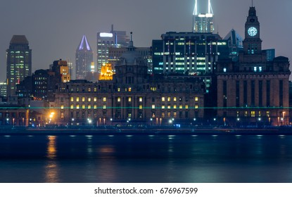 City Skyline By River Against Sky at night in city of China.