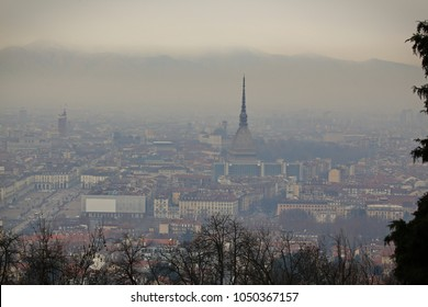 City skyline covered in a dense smog and pollution, Turin, Italy.