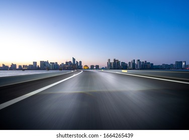 city skyline with empty asphalt raod