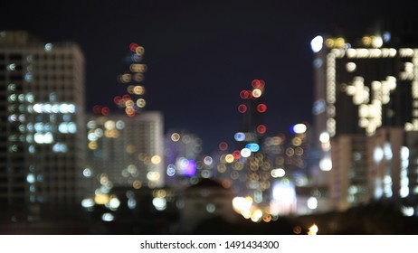 City skyline light at night. blur bokeh defocus Bangkok city skyline night light. Buildings light in metropolis. business and city life concepts background.