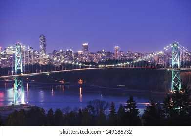 city skyline and Lions Gate Bridge spanning Burrard Inlet Vancouver British Columbia Canada