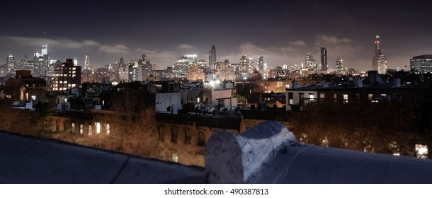 City Skyline. Manhattan, Seen from Brooklyn at Night.