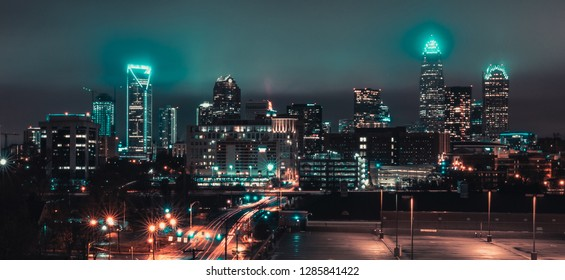 City skyline photo taken during a cloudy night in Charlotte, NC