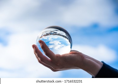 The city skyline is reflected in a crystal ball against a blue sky,Norway,Tromso