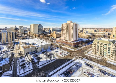 The city skyline of Saskatoon, Saskatchewan in winter on a sunny cold day.