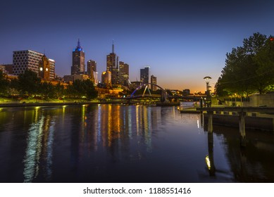 city skyline sunrise reflections Melbourne Yarra river clear calm riverbank