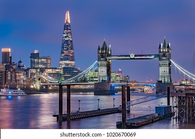 City skyline at sunset with London Tower Bridge and the Shard on Thames river in England