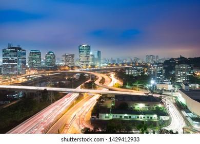 City skyline and traffic on highway at night, Sao Paulo, Brazil