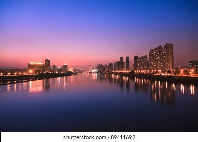 City skyline at twilight.Cityscape  by the river of Minjiang,Fuzhou,China