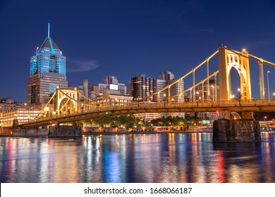 City skyline view over the Allegheny River and Roberto Clemente Bridge in downtown Pittsburgh Pennsylvania USA