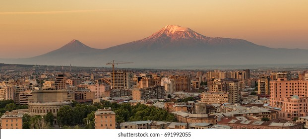 City skyline of Yerevan, Armenia at sunrise, with Mt Ararat in background