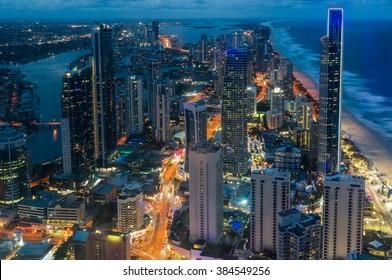 City skyscrapers at night, aerial, long exposure.Futuristic cityscape, Surfers Paradise, Gold Coast, Queensland, Australia