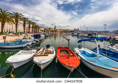 City of Split with colorful fishing boats in harbor, Dalmatia, Croatia. Waterfront view of fishing boats at mediterranean scenery in old roman town Split, Croatia.