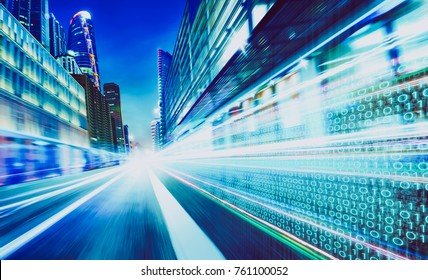 City street with binary code numbers on motion blurred asphalt  road , speed and faster digital matrix technology information concept .