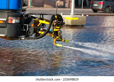 City street cleaning with water jets