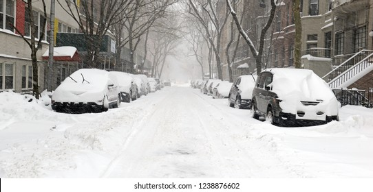 City street covered in snow in Manhattan New York during Noreaster snowstorm
