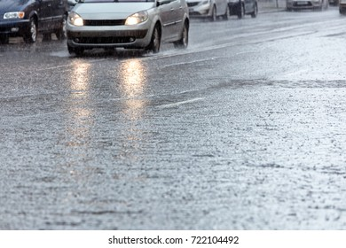city street during heavy rain. rain dropping on asphalt road.