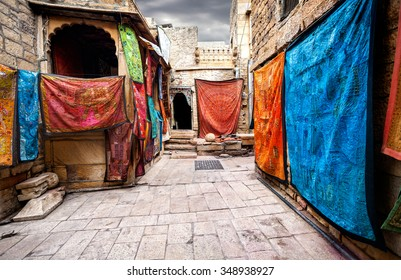 City street market with shops of Jaisalmer fort in Rajasthan, India